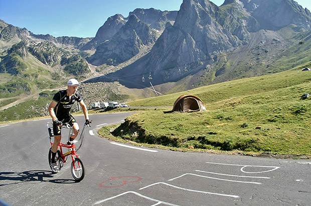 PIC BY MERCURY PRESS (PICTURED: DAVID SIMS ON HIS RALEIGH CHOPPER IN THE ALPS ON THE OFFICIAL TOUR DE FRANCE ROUTE) The man who rode the Tour de France route on a Raleigh Chopper was so ill and exhausted  by when he reached Paris he couldn't get out of bed to see the race. Dave Sims rode over 1,600 miles on the route of the most hotly contested bike race in the world raising thousands for help for heroes. He also received a video message from Chris Froome and was treated by Team Sky's physios after an awkward ride left him with an ankle injury.  SEE MERCURY COPY