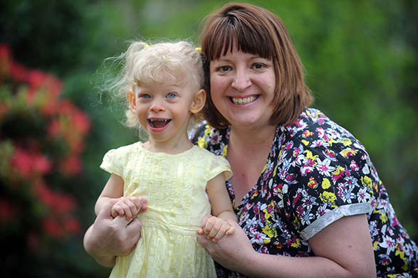 PIC FROM MERCURY PRESS/CATERS NEWS (PICTURED: LAUREN TAYLOR WHO SUFFERS FROM WILLIAMS SYNDROME WITH HER MUM, KATHERINE) A special girl suffers with a rare condition that makes her extremely FRIENDLY. Little Lauren Taylor, three, has Williams Syndrome, one of the side effects of which means she will say hello to everyone. Mum Katherine, 37, says it takes her hours to do the supermarket shopping because Lauren has to say hi to everyone. The condition has also left the youngster with development delays. She is estimated to be around one year behind her peers.  SEE MERCURY COPY