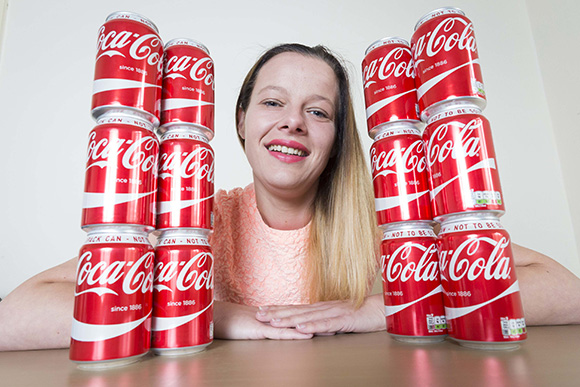 PIC FROM MERCURY PRESS (PICTURED: Sarah Turner, 27, from Birmingham with cans of coke. Sarah used to be addicted to drinking coca cola but has since cut it out of her diet and has managed to drop eight dress sizes) A woman who was addicted to coke and drank four litres a day loses nearly half her body weight after giving it up. Sarah Turner from Kingstanding, Birmingham, dropped eight dress sizes and lost eight stone after ditching her unhealthy habits thanks to Slimming World. The 27-year-old single mum of three was consuming around 432g of sugar a day and claims she lost the weight by cutting it out of her diet - and still doesn't eat fruit, vegetables or salad. SEE MERCURY COPY