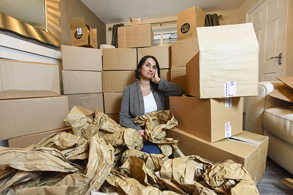 PIC BY DAN ROWLANDS/MERCURY PRESS (PICTURED: JOANNE MURPHY, 39, LOOKS FRUSTRATED SURROUNDED BY THE 48 BOXES DELIVERED BY TESCO) A couple were left with a mountain of cardboard in their living room after a supermarket delivered their new dinner set in 48 SEPARATE boxes. Joanne and Billy Murphy were stunned when each plate, bowl and mug in the 24-piece set they ordered online from Tesco showed up in their own individual boxes, which were then inside even bigger boxes. Already unimpressed at having waited 14 days for the goods to arrive, Joanna took to social media to vent her fury as despite the extreme packaging, five items still broke during delivery. The boxes took up so much space that the family, from Ashton-under-Lyne, Greater Manchester, couldn't see the living room floor once the items were unwrapped. SEE MERCURY COPY