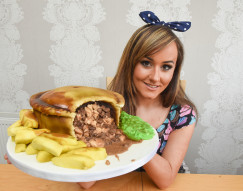 PIC BY IAIN WATTS/MERCURY PRESS (PICTURED:  MOLLY ROBBINS WITH HER MEAT AND POTATO PIE CAKE) A young woman who taught herself to bake now spends hours crafting amazingly realistic cakes which look just like SAVOURY SNACKS. Former makeup artist Molly Robbins, from Rossendale, Lancs, became a cake artist after she got an amazing reaction when she baked a sweet treat for a friend. The 25-year-old - who is the daughter of Phoenix Nights legend Ted Robbins - set up business Mollys Creative Cakes three years ago and prides herself on making quirky and unusual cakes for her customers.  SEE MERCURY COPY