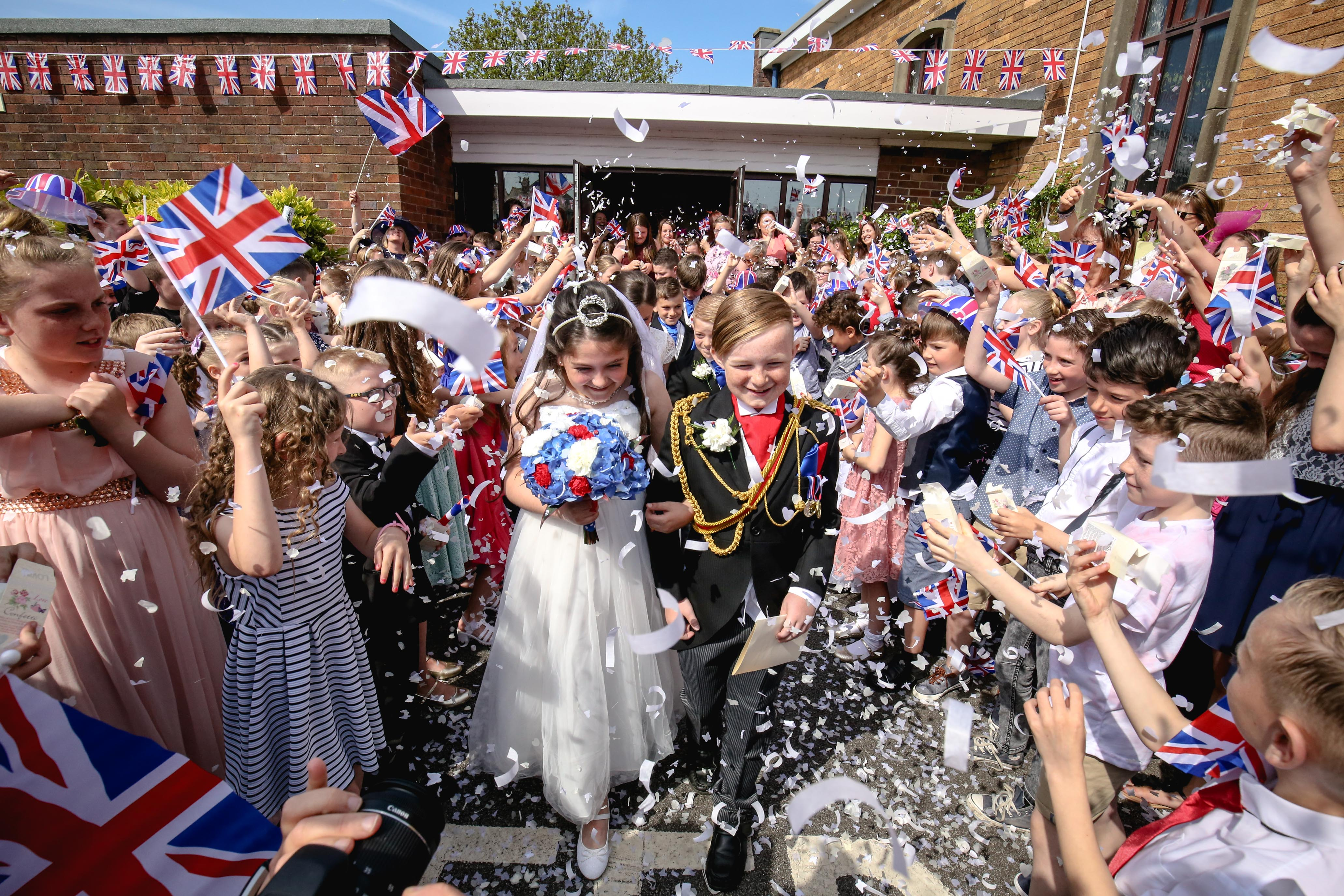PROUD TO BE BRITISH! HUNDREDS OF SCHOOLCHILDREN SET TO STAGE MOCK WEDDING CEREMONY – COMPLETE WITH HORSE-DRAWN CARRIAGES